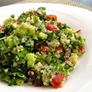 Quinoa Salad ingredients include cucumbers tomatoes and feta